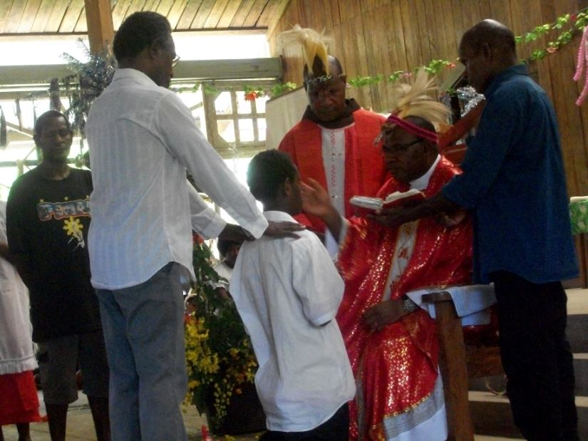 Bishop Michael administering Confirmation in the Aitape Diocese