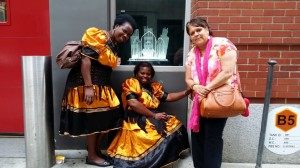 Edina and Bernadette from Zambia, and Kathy from Australia outside a memorial of St Francis Church where a priest was killed during the 9/11 attacks
