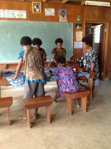 Sr Korina Kirepe assisting the women who cut and sew skirts